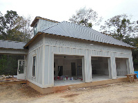 Quad-Lock Insulated Concrete Forms IBHS Fortified for Safer Living Hurricane Rated Home, 3 car garage image, in Fairhope, AL - ICF & More, OKC