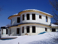 Quad-Lock Insulated Concrete Forms Net-Zero Energy Green Home, exterior radius walls image, in Leverett,MA - ICF & More, OKC